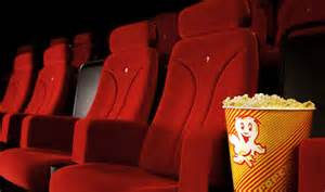 Movie theater seats with popcorn